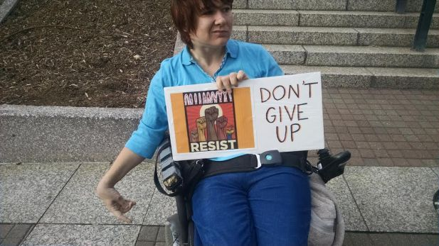Amanda was one of our most reliable rally people. Her friend Russ made this Resist graphic.